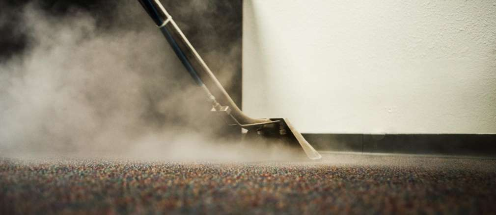 Steam cleaning a carpet
